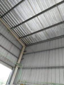 Heat insulated metal roofing and cladding sheets
